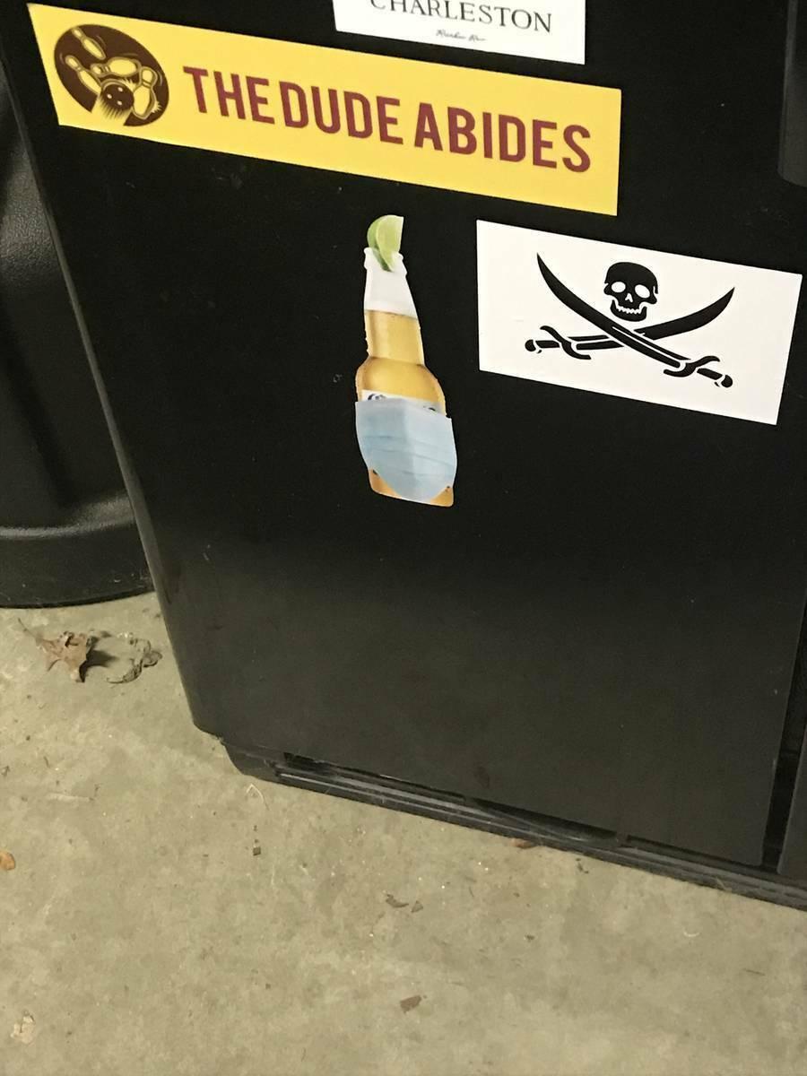 Scott's photograph of their Coronavirus Beer Bottle with Mask Sticker