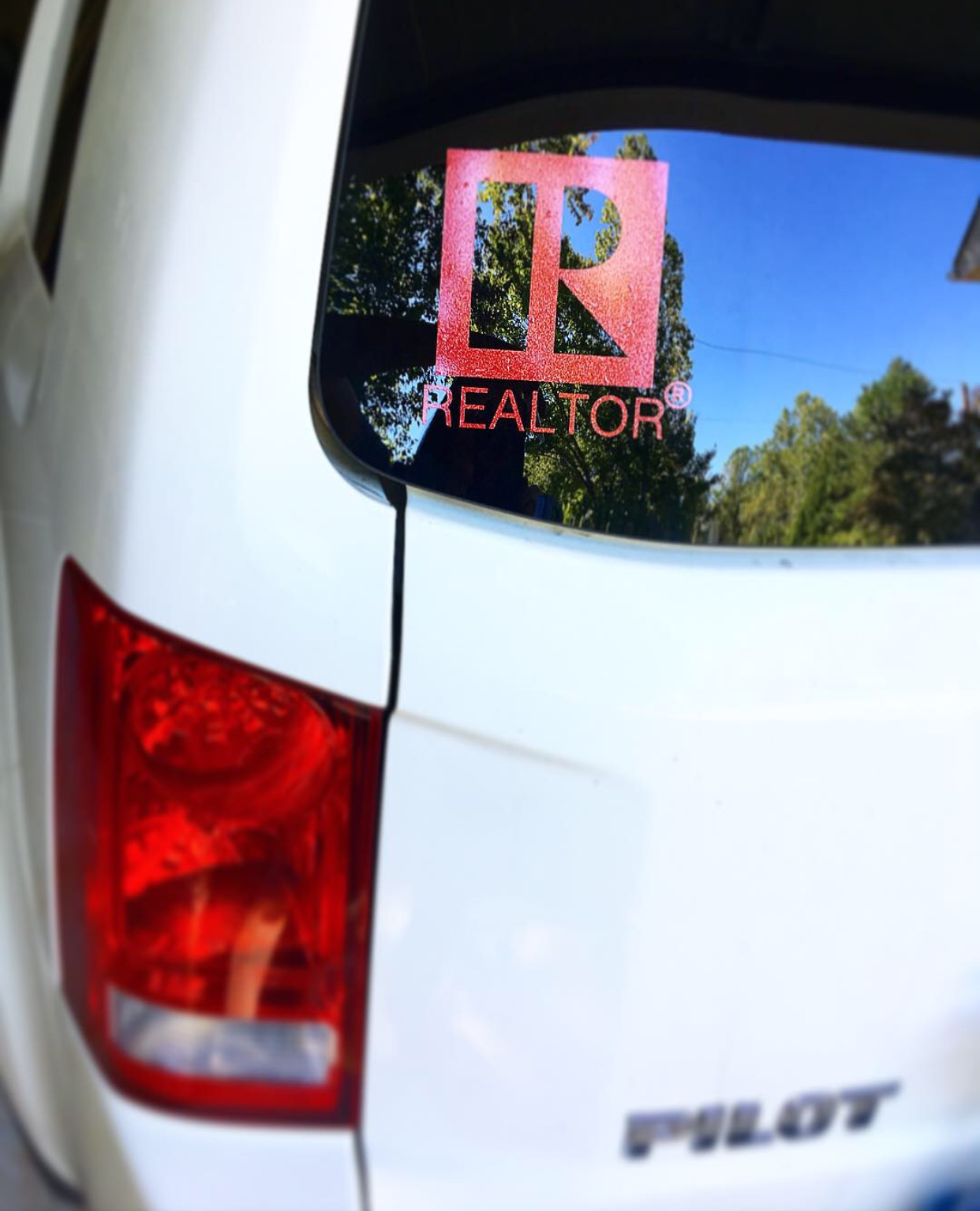 Erika's photograph of their Realtor Real Estate Agent Sticker