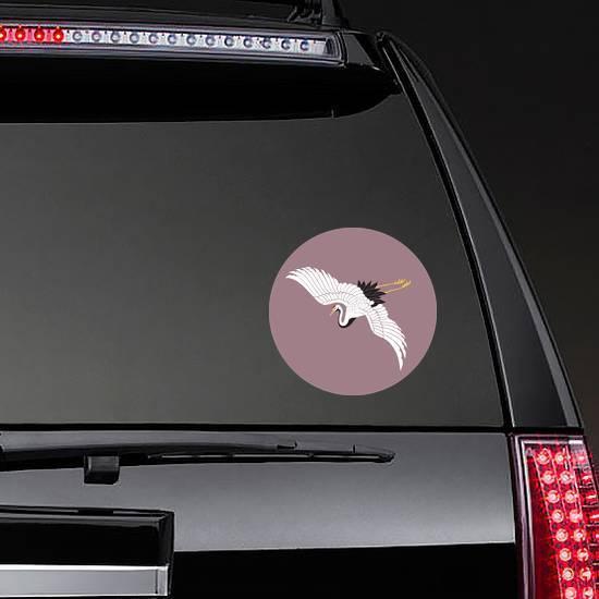 Japanese White Crane On Mauve Background Sticker example