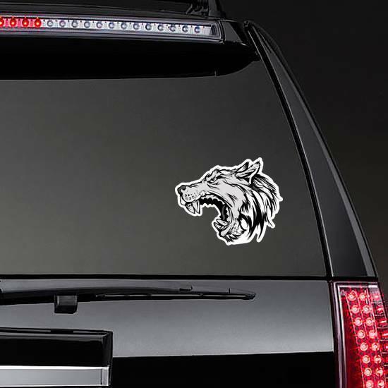 Cartoon Growling Grey Wolf Head Sticker on a Rear Car Window example