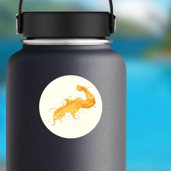 Orange Juice Splash In Form Of Arm Muscle Fitness Sticker