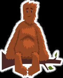 Hairy Cartoon Bigfoot Sitting On Branch Sticker