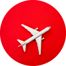 Metal Toy - Airplane Stand On Red Paper Background Sticker