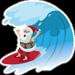 Santa Claus Surfing A Gnarly Wave Sticker