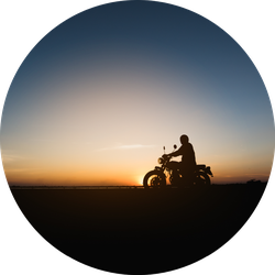 Silhouette Of Young Man Biker With Sunset Sticker