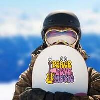 Retro Style Peace Love Music Hippie Sticker on a Snowboard example