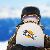 Charismatic Jumping Lion Logo Sticker on a Snowboard example