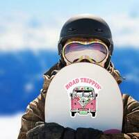 Road Trippin Pink Hippie Van Sticker on a Snowboard example