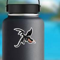 Cute Happy Flying Black Dragon Sticker on a Water Bottle example
