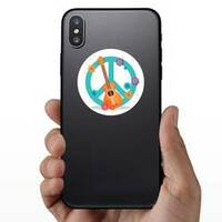 Guitar & Flowers Hippie Peace Symbol Sticker on a Phone example
