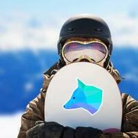 Blue Geometric Fox Head Sticker on a Snowboard example