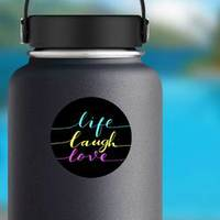 Live, Laugh, Love Vibrant Colors On Black Sticker example