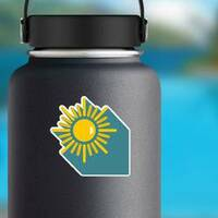 Sun with Shadow Sticker on a Water Bottle example