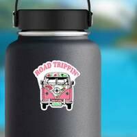 Road Trippin Pink Hippie Van Sticker on a Water Bottle example