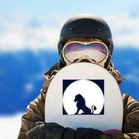 Lion Sitting On A Rock Looking At The Moon Sticker on a Snowboard example