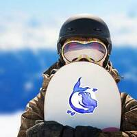 Blue Watercolor Silhouette Sticker on a Snowboard example