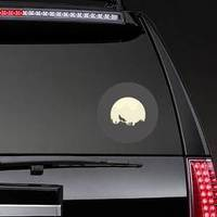 Silhouette Of A Howling Coyote In Front Of The Moon Sticker example