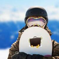 Briefcase Full of Money Sticker on a Snowboard example