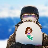 Tiny Mermaid Sticker on a Snowboard example