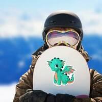 Cute Baby Teal Dragon Cartoon Sticker on a Snowboard example
