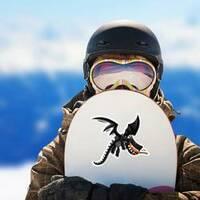 Cute Happy Flying Black Dragon Sticker on a Snowboard example