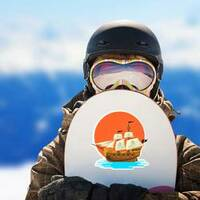 Pirate Ship at Sunset Sticker on a Snowboard example
