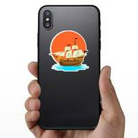 Pirate Ship at Sunset Sticker on a Phone example