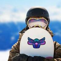 Owl Holding Skull Sticker on a Snowboard example