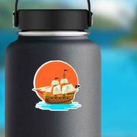 Pirate Ship at Sunset Sticker on a Water Bottle example