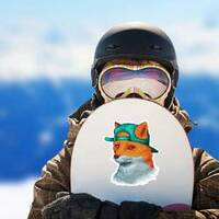 Awesome Fox Wearing Backward Hat Sticker on a Snowboard example