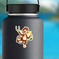 Cartoon Monkey On A Tree Branch Holding Banana Sticker on a Water Bottle example