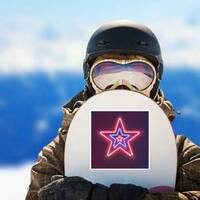 Three Shining Neon Stars Sticker on a Snowboard example