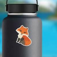 Cute Fox Posing Sticker on a Water Bottle example