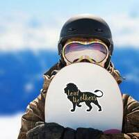 Lead The Others Lion Sticker on a Snowboard example
