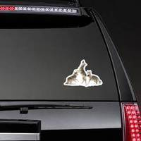 Three Coyotes Jumping In Snow Sticker example