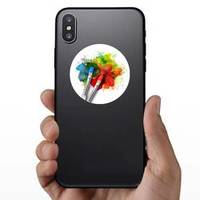 Two Paint Brushes Are Painting A Rainbow Splatter Art Project Sticker example