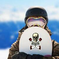 Skull with Crossed Guns and Roses Sticker on a Snowboard example