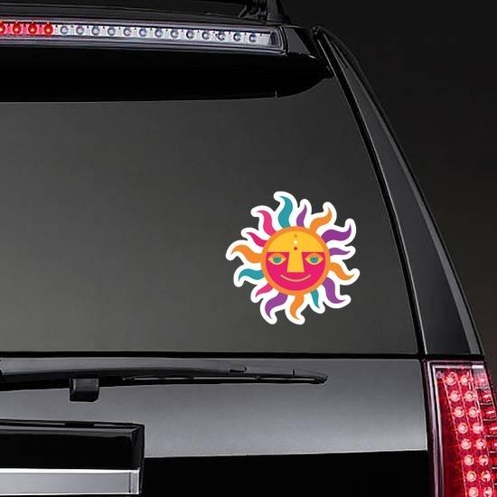 Colorful Sun Hippie Sticker on a Rear Car Window example