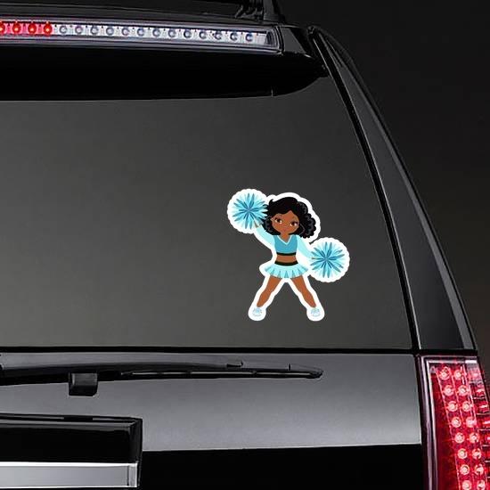 Cartoon Cheerleader with Teal Pom Poms Sticker on a Rear Car Window example