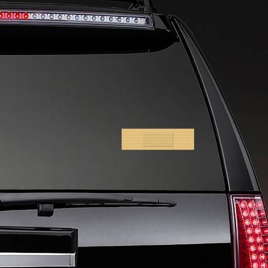 Rectangular Band Aid Bandage Sticker on a Rear Car Window example