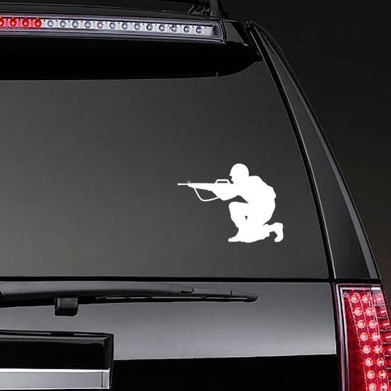 Soldier Aiming Gun Sticker on a Rear Car Window example