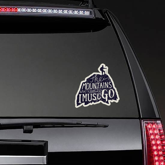 The Mountains Are Calling Sticker on a Rear Car Window example