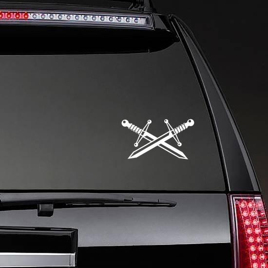 Two Crossed Swords Sticker on a Rear Car Window example