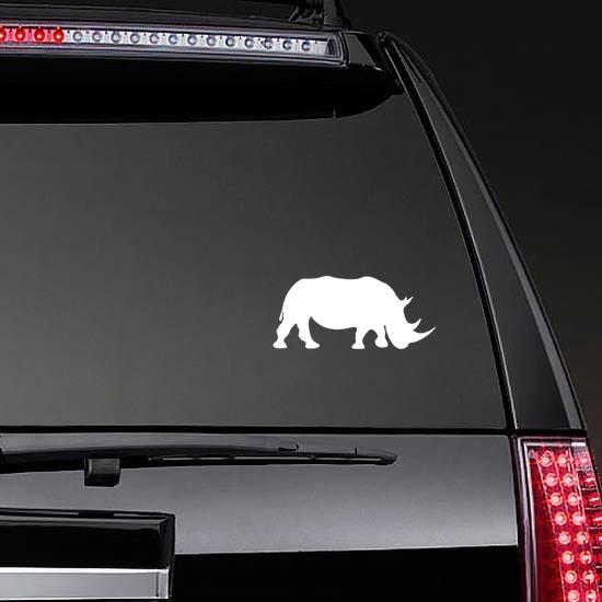 Walking Rhinoceros Sticker on a Rear Car Window example