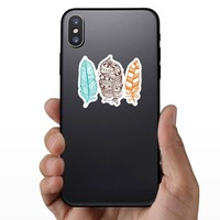 3 Colorful Feathers Sticker on a Phone example
