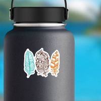 3 Colorful Feathers Sticker on a Water Bottle example