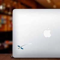 Space X Icon Sticker on a Laptop example
