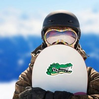 Angry Gator Head Mascot Sticker on a Snowboard example
