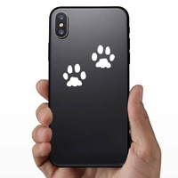 Animal Paw Prints Sticker on a Phone example