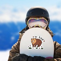 Be Kind Camping Sticker on a Snowboard example
